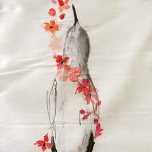 Bird with flower garland